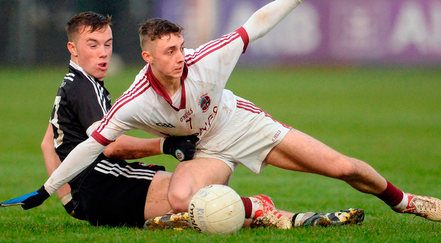 Slaughtneil's Keelan Feeney and Martin Devlin of Kilcoo battle for the ball. Photo: Oliver McVeigh/Sportsfile
