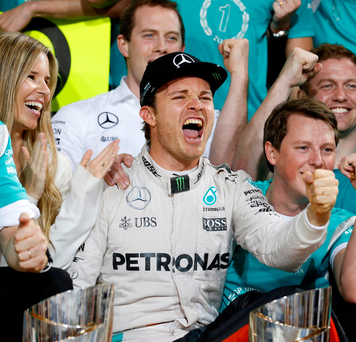 Nico Rosberg celebrates after claiming his first Formula One drivers' title. Photo: Ahmed Jadallah/Reuters
