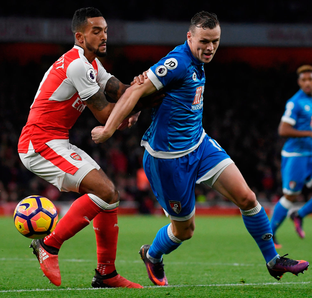 Arsenal's Theo Walcott in action with Bournemouth's Brad Smith. Photo: Toby Melville/Reuters