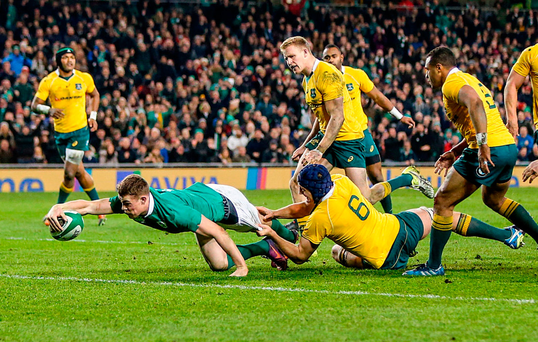 Garry Ringrose stretches across the line to score Ireland's second try despite the tackle of Dean Mumm. Photo by John Dickson/Sportsfile