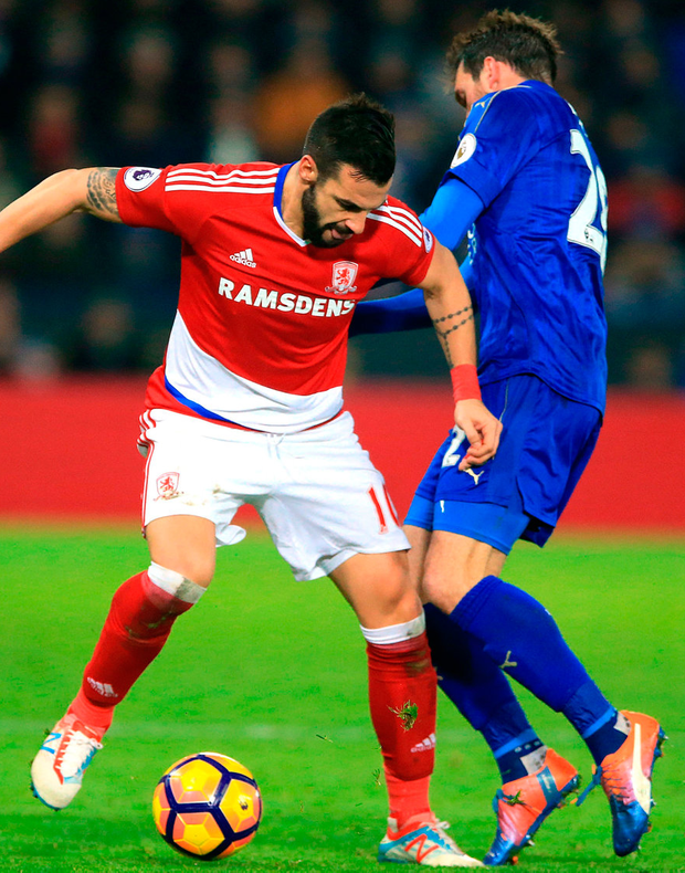 Middlesbrough's Alvaro Negredo (left) and Leicester City's Christian Fuchs battle for the ballb during the Premier League match at the King Power Stadium. Photo: Nigel French/PA