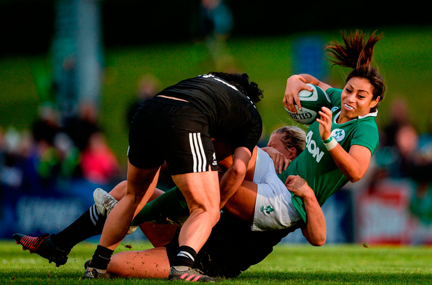 Ireland's Sene Naoupu is tackled by All Blacks Chelsea Alley and Portia Woodman. Photo: Eóin Noonan/Sportsfile