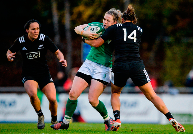 Ireland's Claire McLaughlin is tackled by New Zealand's Honey Hireme. Photo by Eóin Noonan/Sportsfile