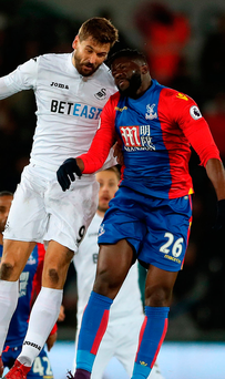 Swansea City's Fernando Llorente and Crystal Palace's Bakary Sako battle for the ball during the Premier League match at the Liberty Stadium. Photo: Nick Potts/PA