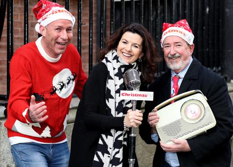 Comedian Deirdre O'Kane with Garvan Rigby (left) and Walter Hegarty from Christmas FM at the station's launch. Photo: Maxwells