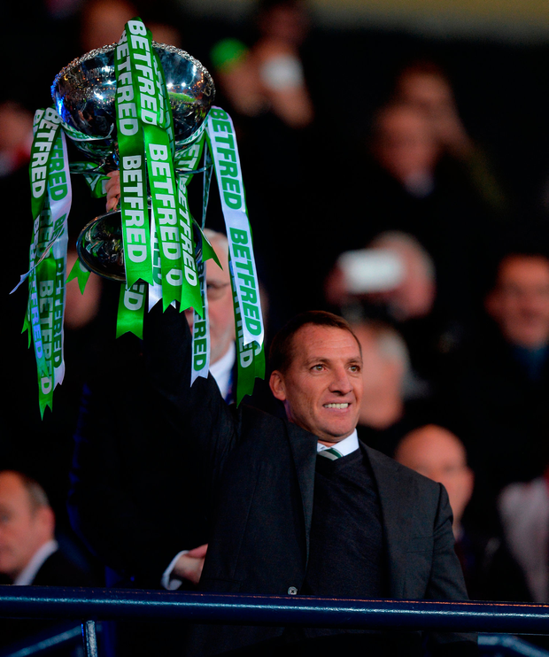 Celtic manager Brendan Rodgers lifts the trophy. Photo: Getty