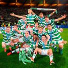 Celtic's players celebrate after winning the Scottish League Cup. Photo: PA