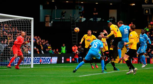 Stoke City's Charlie Adam heads the ball, which deflects off Watford goalie Heurelho Gomes to give Stoke their goal. Photo: PA