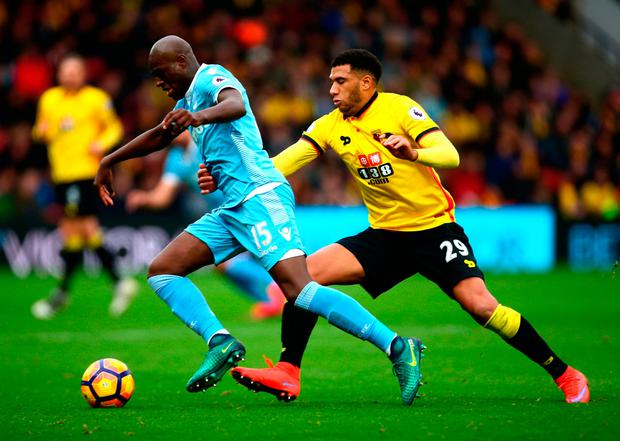 Stoke's Bruno Martins Indi and Watford's Etienne Capoue battle for possession. Photo: Getty