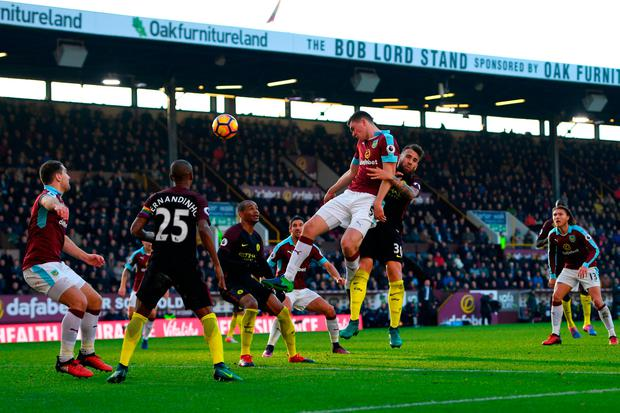 Burnley's Michael Keane heads the ball. Photo: Getty