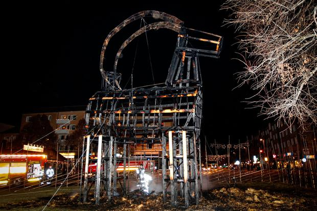 The traditional Christmas goat is seen after it was burned down in Gavle, Sweden. Picture: Pernilla Wahlman/TT News Agency via AP