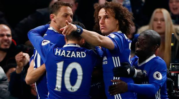 Chelsea's Victor Moses celebrates scoring their second goal with team mates