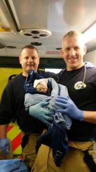 Tallaght firefighters with the newborn baby