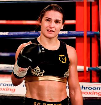 Katie Taylor celebrates after her Super-Featherweight fight with Karina Kopinska at Wembley Arena in London, England. Photo: Stephen McCarthy/Sportsfile