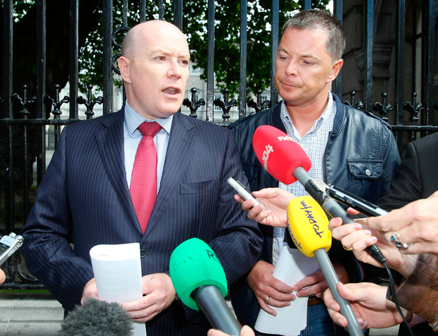 Austin Stack (left) and brother Oliver speak to media outside Leinster House about the shooting of their father, chief prison officer at Portlaoise Prison Brian Stack on March 25, 1983. Photo: Frank McGrath