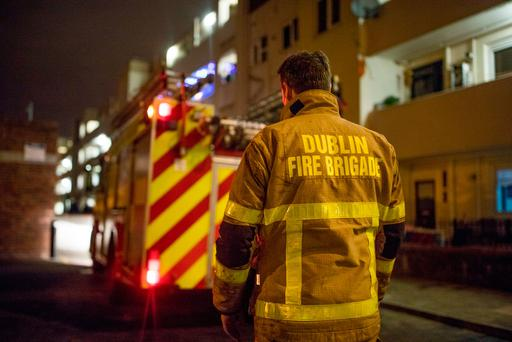 Gardai and Dublin Fire brigade attend a fire at a flat in Pearse House on Pearse street, where a man in his fifties was taken to hospital. Picture: Arthur Carron