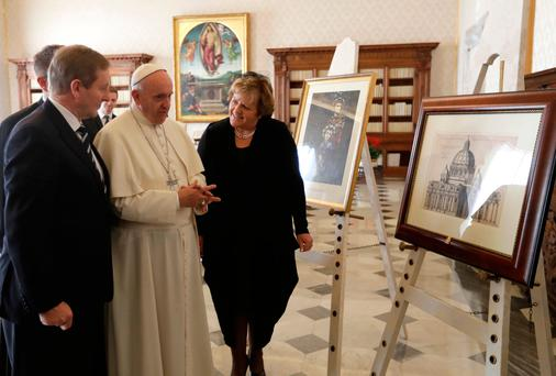 Pope Francis exchanges gifts with Taoiseach Enda Kenny and his wife Fionnuala during a private audience in his studio, at the Vatican. Photo: AP