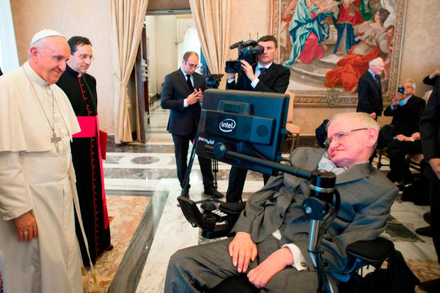 Pope Francis greets renowned physicist Stephen Hawking during a separate audience at the Vatican. Photo: AP