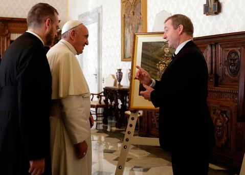 The Taoiseach and and the Pontiff with his translator. Photo: AP