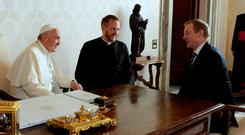 Pope Francis, left, meets Taoiseach Enda Kenny, right, during a private audience in the Vatican yesterday. Photo: Reuters/Alessandra Tarantino