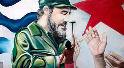 A child plays in front of a mural of late former Cuban leader Fidel Castro at the market in Managua, Nicaragua. REUTERS/Oswaldo Rivas
