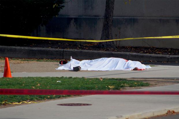 A bloodied body lies outside of the CBEC Building and Koffolt Labs following the attack on Ohio State University's campus in Columbus, Ohio, U.S. November 28, 2016.