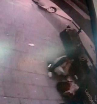 Image taken from CCTV released by the Metropolitan Police of two pedestrians (bottom right) struck by a car in a hit-and-run collision near Scandals nightclub in West Norwood