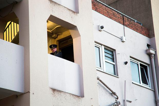 A Garda pictured at the scene of a fire at Pearse House Flats, Pearse St. Photo: Colin O'Riordan