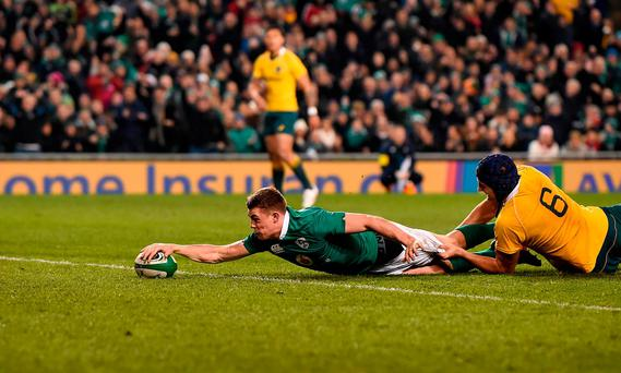 Garry Ringrose of Ireland scores his side's second try despite the tackle of Dean Mumm of Australia during the Autumn International match between Ireland and Australia at the Aviva Stadium in Dublin. Photo by Brendan Moran/Sportsfile