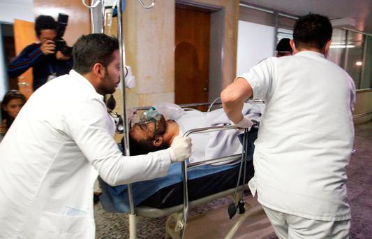 Brazilian soccer player Alan Luciano Ruschel of Chapecoense soccer club receives medical attention after a plane crash in Antioquia, central Colombia November 29, 2016. REUTERS/Guillermo Ossa/EL TIEMPO