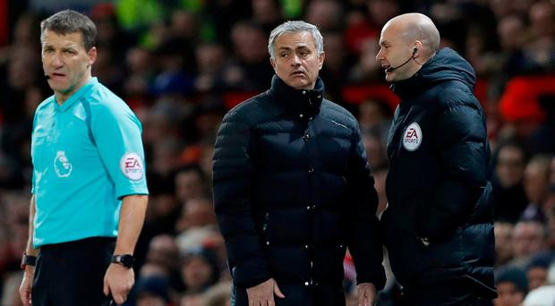 Manchester United manager Jose Mourinho with fourth official Anthony Taylor before being sent to the stands at the weekend Action Images via Reuters / Carl Recine