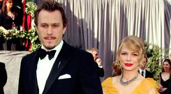 Actors Heath Ledger and Michelle Williams arrive to the 78th Annual Academy Awards at the Kodak Theatre on March 5, 2006 in Hollywood, California. (Photo by Frazer Harrison/Getty Images)