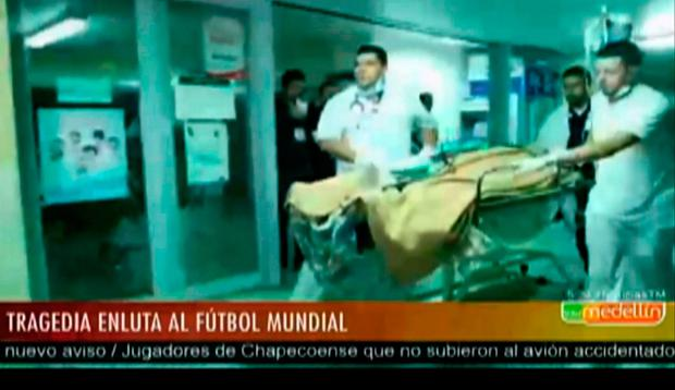 A survivor of the air crash near Medellin, Colombia arrives a hospital in Medellin in this image taken from TV. Picture: Medellin TV via AP