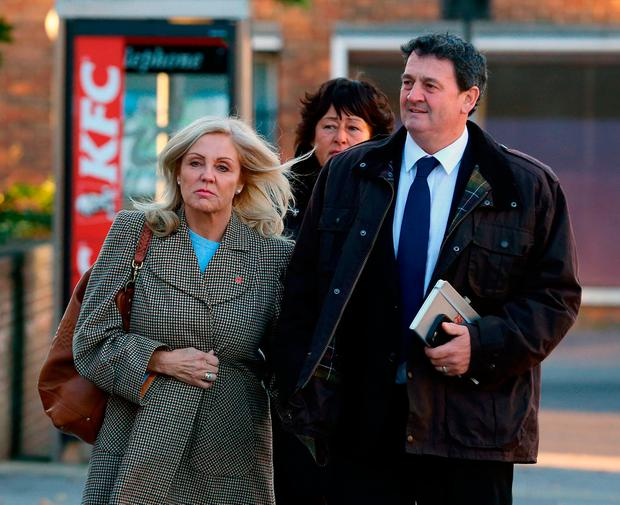 Paul Price, the stepfather of model Katie Price, is accompanied by his wife Amy Price as he arrives at Chichester Crown Court, where he is standing trial accused of rape Credit: Gareth Fuller/PA Wire