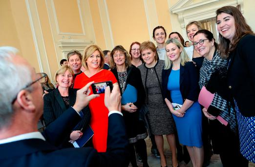 Senator Kevin Humphreys taking a photo of First Minister of Scotland Nicola Sturgeon and members of the Seanad. Photo: Maxwells