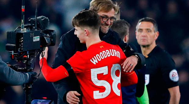 Liverpool's Ben Woodburn and manager Jurgen Klopp celebrate after the game