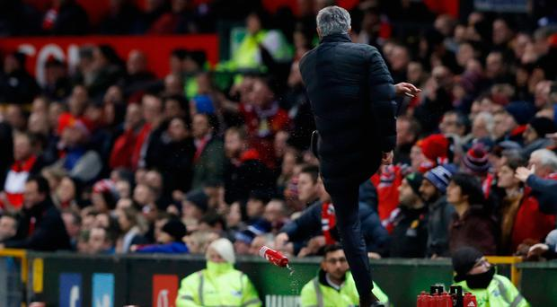 Jose Mourinho kicks a water bottle during Manchester United's game against West Ham at Old Trafford. Photo: Reuters