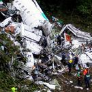Rescue crews in the wreckage of the plane that crashed into Colombian jungle. Photo: Reuters.