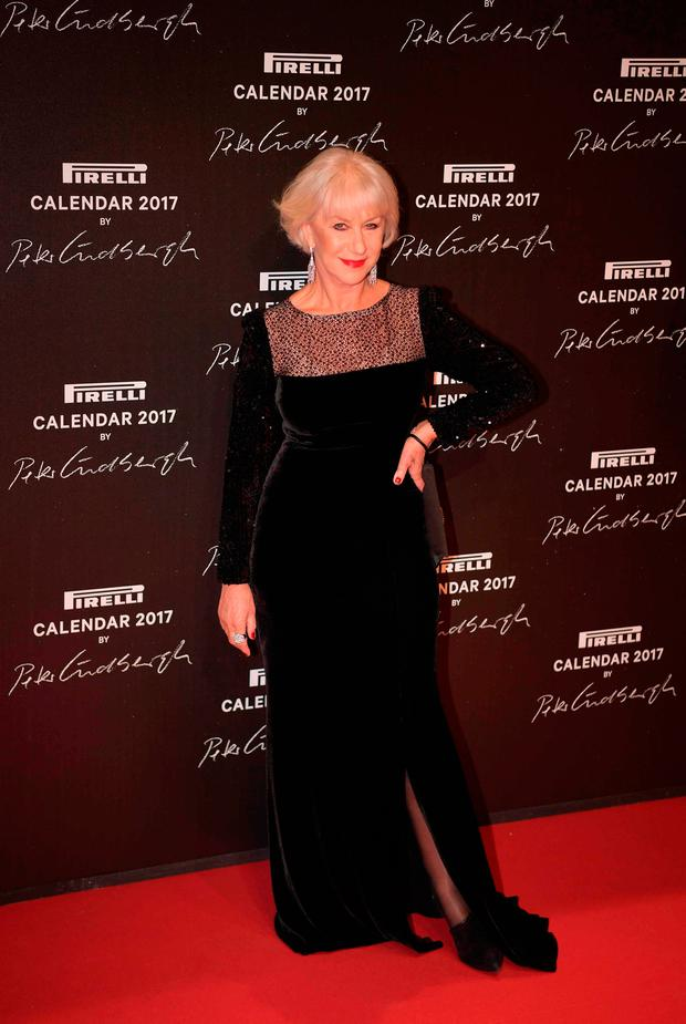 British actress Helen Mirren poses during a photocall ahead of a gala dinner held for the international launch of the 2017 Pirelli calendar, at the Cite du Cinema in Saint-Denis north of Paris, on November 29, 2016.