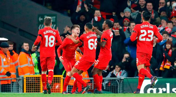 Liverpool's Ben Woodburn celebrates scoring his first goal for Liverpool