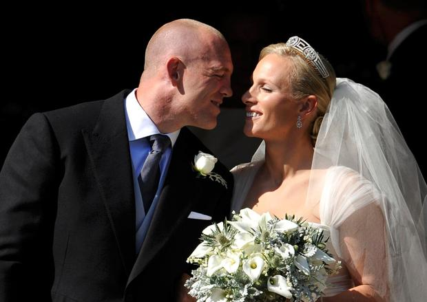 England rugby captain Mike Tindall and Zara Phillips kiss as they leave the church after their marriage at Canongate Kirk on July 30, 2011 in Edinburgh, Scotland