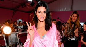 Kendall Jenner poses prior the 2016 Victoria's Secret Fashion Show on November 30, 2016 in Paris, France. (Photo by Dimitrios Kambouris/Getty Images for Victoria's Secret)