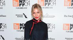 Sienna Miller in a Prada tunic-style top