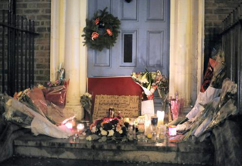Flowers and cards pictured in the doorway where Jonathan Corrie died on Dublin's Molesworth Street. Photo: Frank Mc Grath