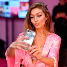 Gigi Hadid has her Hair & Makeup done prior the 2016 Victoria's Secret Fashion Show on November 30, 2016 in Paris, France. (Photo by Pascal Le Segretain/Getty Images for Victoria's Secret)