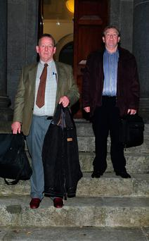 Brothers Cyril and James Goonan, leaving Tullamore Courthouse, where an inquest is taking place into the death of their brother James. Photo: APX