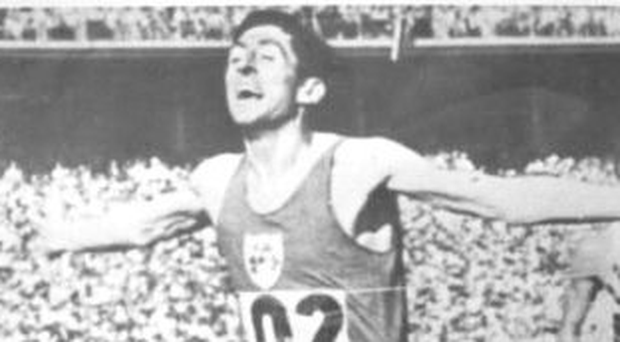 Ronnie Delany crosses the finish line in the 1500m final at the 1956 Olympics in Melbourne
