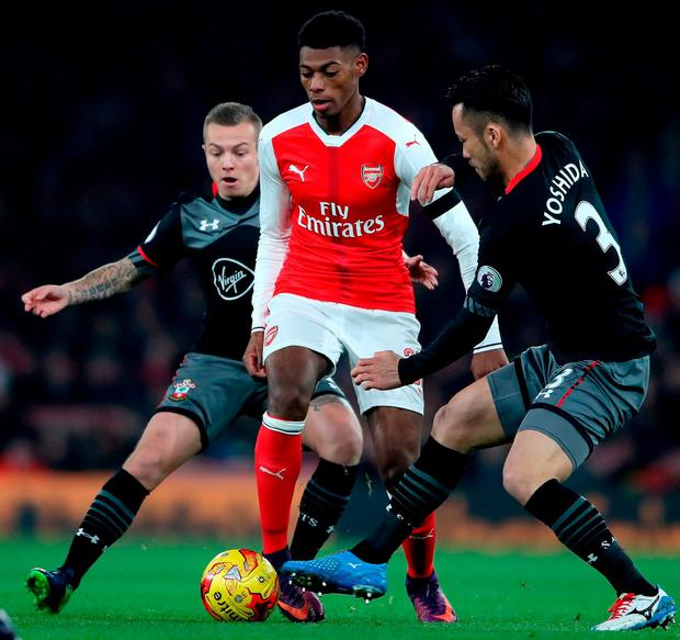 Arsenal's Jeff Reine-Adelaide (centre) battles for the ball with Southampton's Jordy Clasie (left) and Southampton's Maya Yoshida (right). Photo: Nick Potts/PA Wire.