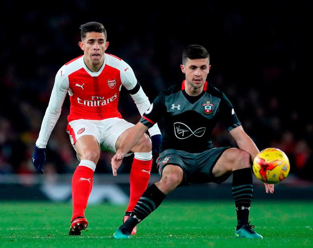 Arsenal's Gabriel Paulista (left) and Southampton's Shane Long (right) battle for the ball. Photo: Nick Potts/PA Wire.