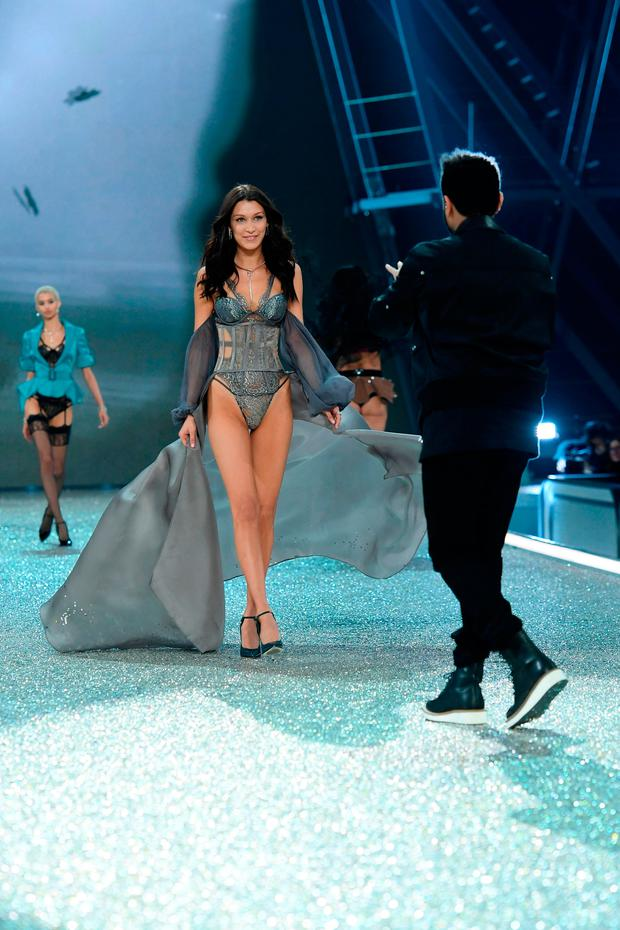 Bella Hadid and The Weeknd walks the runway during the 2016 Victoria's Secret Fashion Show on November 30, 2016 in Paris, France. (Photo by Dimitrios Kambouris/Getty Images for Victoria's Secret)